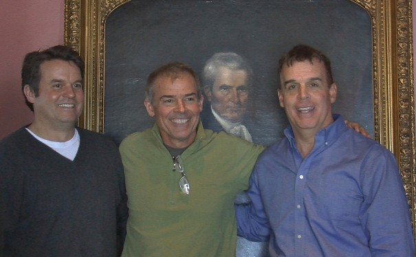 Frank, Jim and Tom Marshall pose with portrait of Chief Justice John Marshall at the Henderson County Heritage Museum.