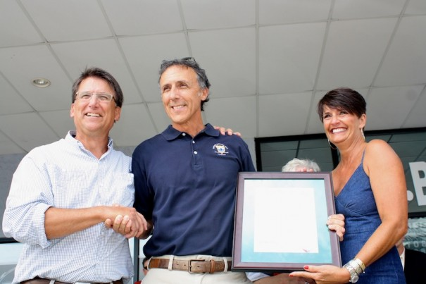 Gov. Pat McCrory presents Jeff Miller with the Order of the Long Leaf Pine as Tamara Miller looks on.