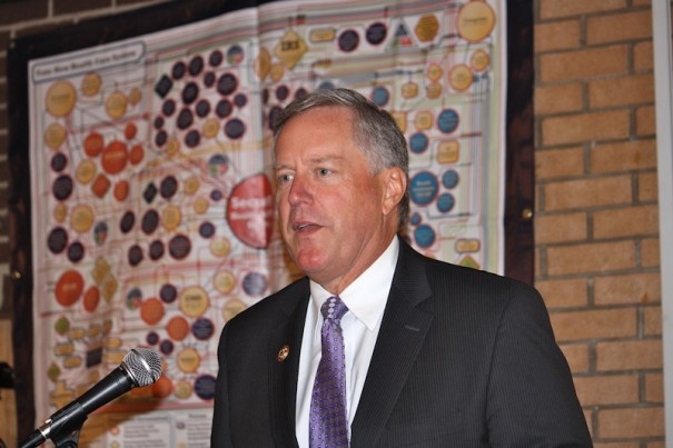 U.S. Rep. Mark Meadows, in front of a sign purporting to show how the Affordable Care Act works, speaks at a FreedomWorks event.