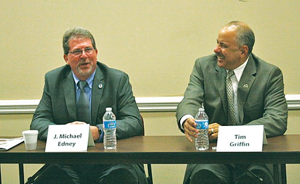 Michael Edney and Tim Griffin share a laugh during a Chamber of Commerce forum on April 23.
