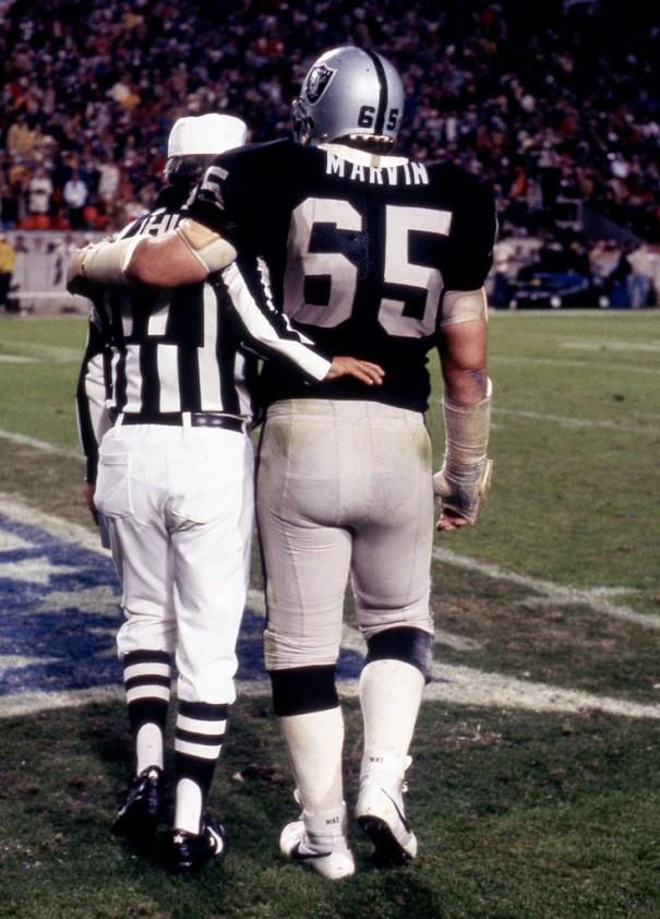 Mickey Marvin is shown walking off the field with an official after the Oakland Raiders won Super Bowl XVIII in Tampa.