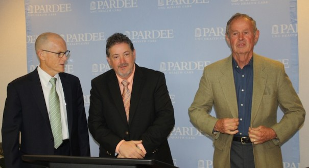 UNC Health Care CEO Gary Park, county commission Chairman Charlie Messer and Pardee board Chairman Bill Moyer announced a new Pardee-UNC agreement.