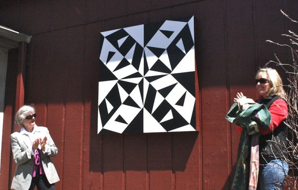 Georgia Bonesteel, left, and Bonnie See unveiled the county's fist quilt block last month at the Flat Rock Playhouse..