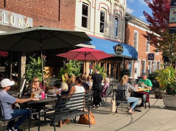 Diners enjoy dinner and beverages at Mezzaluna on Main Street. A Shop & Dine campaign to boost spending at local restaurants and shops has been delayed to the holiday season, the Chamber of Commerce says.