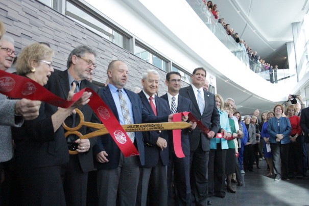 Officials celebrate opening of the Health Sciences Center with a ceremonial ribbon-cutting on Tuesday.