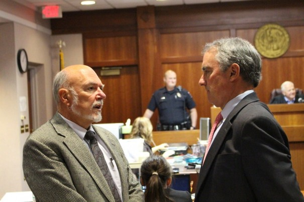 Dr. Michael J. Rosner speaks with his attorney, Scott Stevenson, during jury selection on Aug. 1.