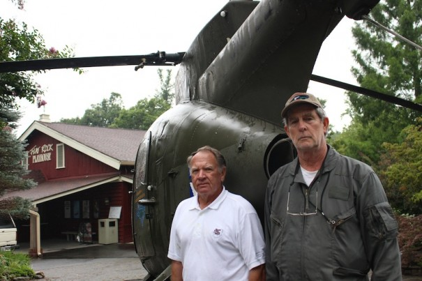 Jerry Seago, who was a chief warrant officer, and Larry Pigg, who retired as a captain, pose with a Vietnam War-era Cayuse observer helicopter at Flat Rock Playhouse.