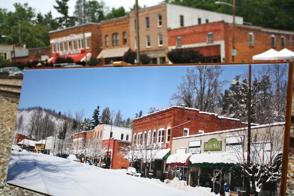 Life mirrors art in a winter photo of Saluda with the town in the background. The photography is from the studio of Jean Jacques and Sue Benoist in Mill Spring.