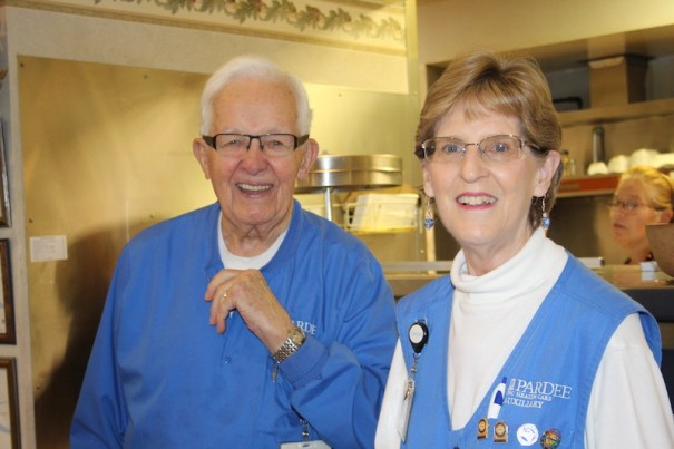 Sandy Brown, with fellow volunteer Bob Walrath, at the Garden Cafe at Pardee Hospital.