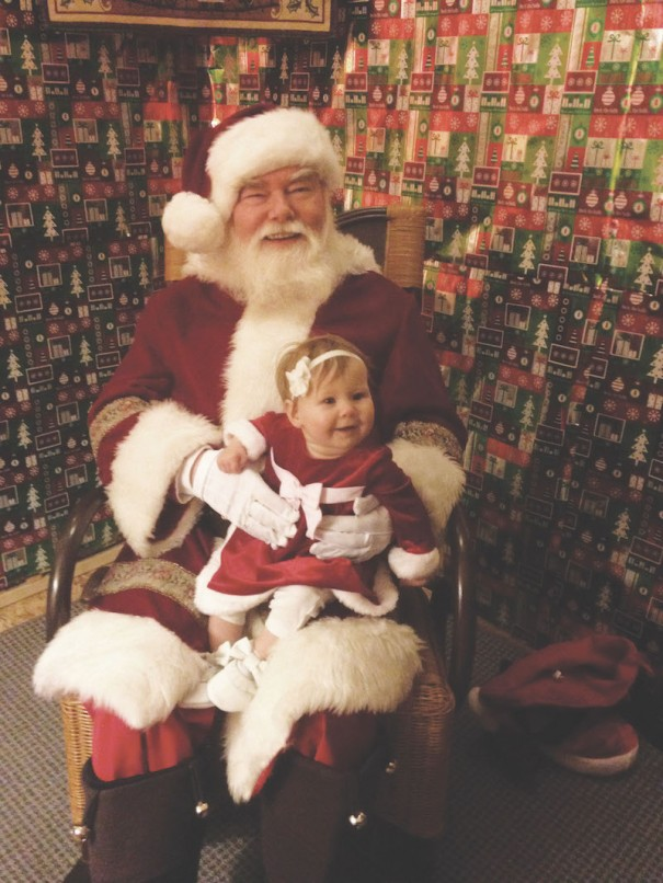 Violet Summey, the daughter of April and Keith Summey, visits Santa at the Santa House in the 700 block of North Main Street.