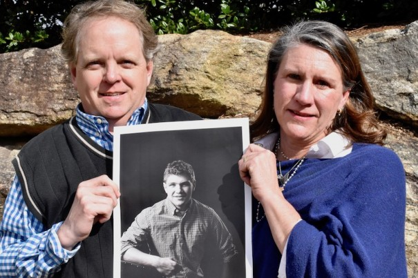 Scott and Amy Donaldson pose with a photo of their son, Seth.