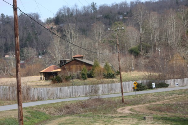A 147-acre parcel of land on the French Broad River also contains a clubhouse built for the planned Seven Falls golf course.