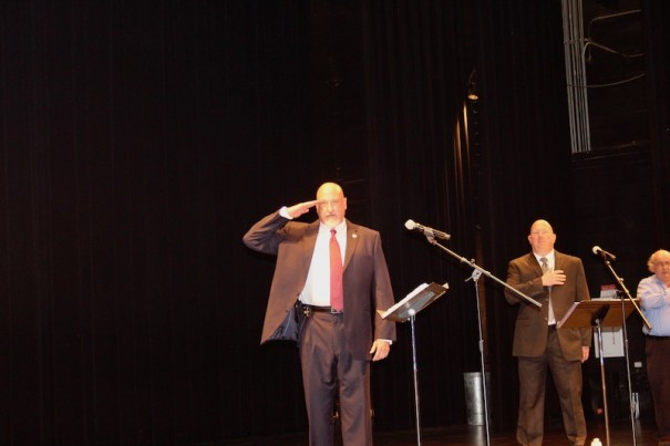 Sheriff Charlie McDonald and challenger Lowell Griffin repeat the Pledge of Allegiance before a candidate forum in April.