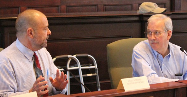 County Manager Steve Wyatt makes a point as Mills River Larry Freeman listens in a meeting in April 2015.
