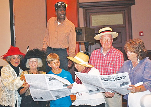 "Cast members rehearsing a scene in ""Sunbonnet and Strawhat"" are Ronnie Pepper, on platform, and, from left, Mary Louise Barber, Carolyn Justus, Jay Mullinax, Rosie O'Brien, Jim Toms and Sandee Carpenter."