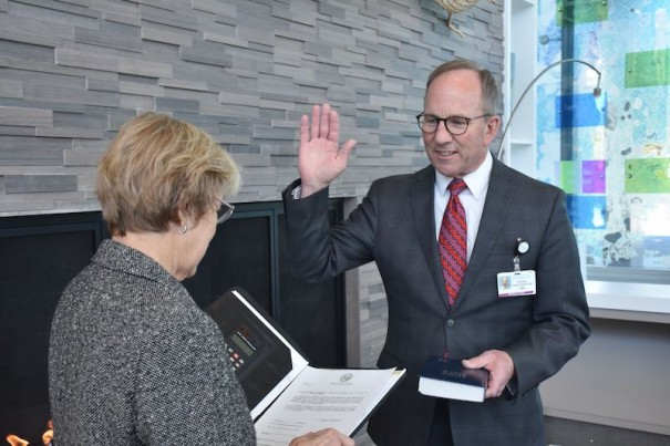 Mayor Barbara Volk administers oath to Dr. Thomas Eisenhauer, who was reappointed to the N.C. Advisory Committee on Cancer Coordination and Control. [PARDEE UNC HEALTH CARE PHOTO]
