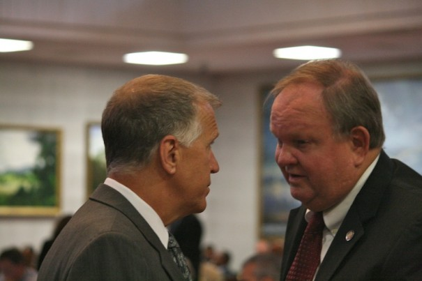State Rep. Chuck McGrady confers with House Speaker Thom Tillis on the House floor in May.