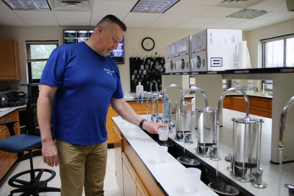 Water Treatment Facility Manager Ricky J. Levi conducts water quality testing in the lab.