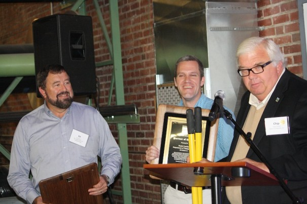 NCDOT division engineer Ed Green and district engineer Steve Cannon receive Partner of the Year award from Chip Gould.