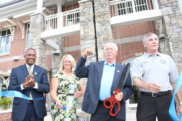 From left, Randall Gore, of the USDA's Rural Development agency, Fletcher Town Council member Sheila Franklin, Mayor Bill Moore and Council member Bob Davy celebrate new Town Hall.