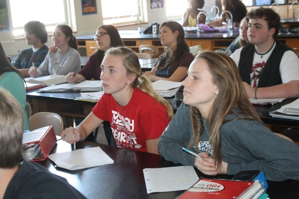 Blaine Hawkins, left, and Sydney Gilliam listen to instructor Jessica Houston in an AP biology class at HHS.