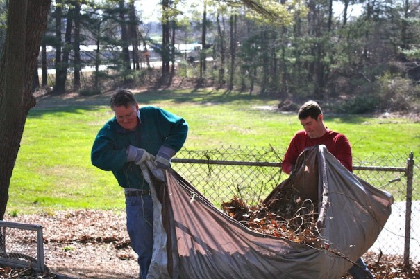 Davids Goliath: David White and David Jacklin drag a tarp filled with leaves to load onto trailer.