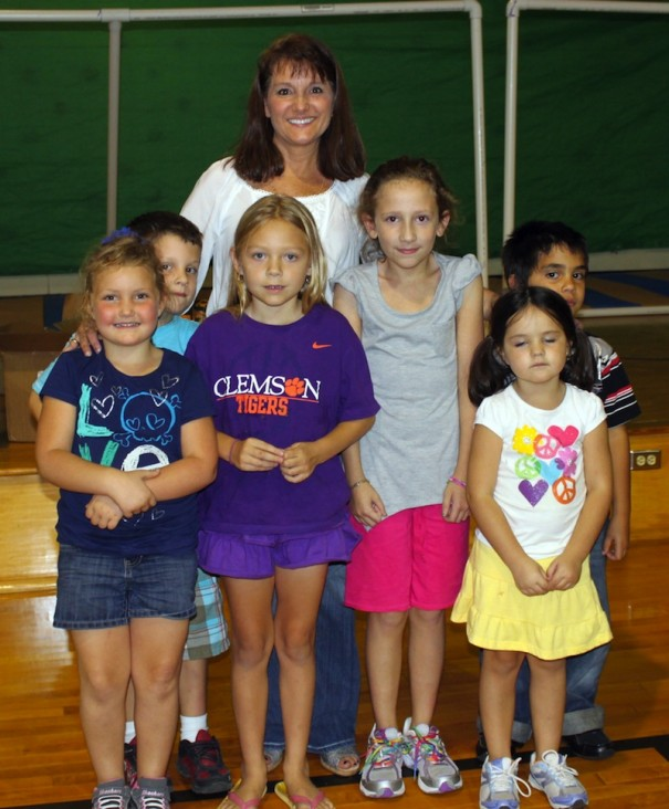 Audrey Reneau poses with students (Photo by Tricia Allen, Henderson County schools)