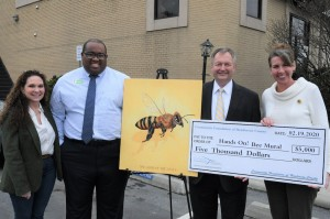 Shown are Tree Board member Mia Freeman; Joseph Knight, executive director of Hands On!; Community Foundation President McCray V. Benson; and Kim Bailey, of the city Environmental Sustainability Board and Bee City USA-Hendersonville coordinator.