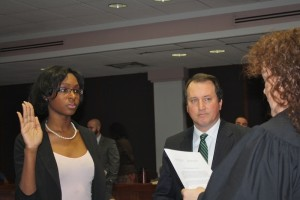 Chelsea Forbes takes the oath of office as assistant district attorney as District Attorney Greg Newman looks on. Chief District Court Judge Athena Brooks administered the oath of office.