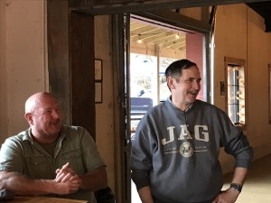 Sheriff Lowell Griffin and the sheriff's office attorney Ron Justice visit with friends during a fundraiser for the family of Ryan Hendrix at Dry Falls Brewing Co.