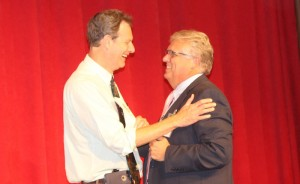 Schools Superintendent Bo Caldwell (right) congratulates HHS principal Bobby Wilkins, the 2016 principal of the year.