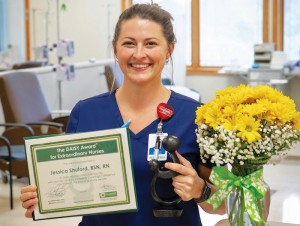 Registered nurse Jessica Shuford poses with Daisy Award.