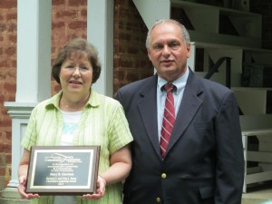 Mary Garrison, winner of the Richard C. and Vina L. Sauer Award, with Randy Romeo, chairman of the Community Foundation of Henderson County.