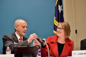 Joey Osborne and Lynda Bennett test a microphone during an 11th Congressional District forum.