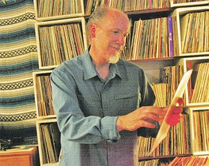 Rob Tolleson looks at one of hundreds of LPs in his collection while working on his 'Spin-terview' show.
