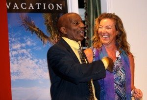 Tracy Stevens celebrates her beach vacation with emcee Ronnie Pepper.