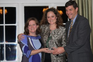 Marisa and Yates Pharr accept Camp Industry Leadership Award from Fair Waggoner (center).