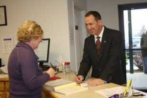 Sheriff's candidate Michael Brown writes a check for filing fee.