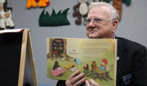 Commissioner reads to children